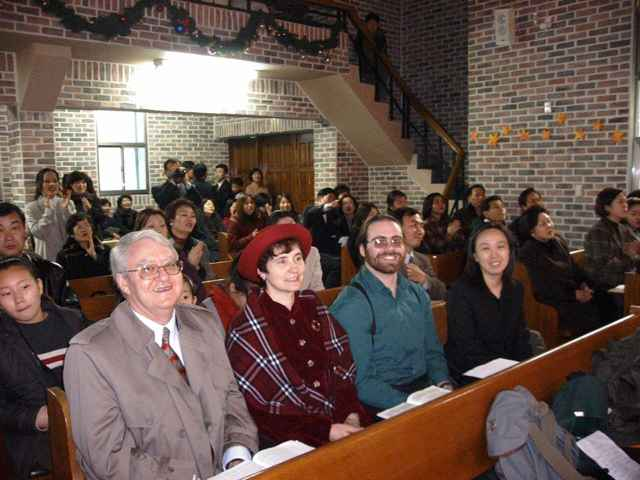 Visiting Sandra's alumnus Yura Han at her Church for Christmas eve service. Listed from right to left, Ron, Sandra, Phillip and Yura.